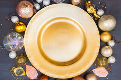 Christmas golden plate. Christmas empty golden plate with gold decorations Stock Image