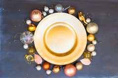 Christmas golden plate. Christmas empty golden plate with gold decorations frame Stock Photos