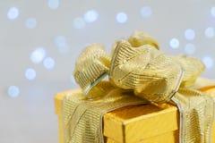 Christmas golden present box Stock Photos