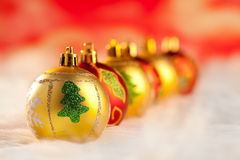 Christmas golden red baubles in a row with lights Royalty Free Stock Image