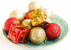 Christmas Golden and Red Globes and Gifts Royalty Free Stock Photography