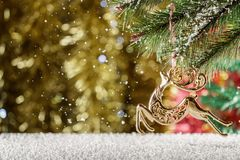 Christmas Golden reindeer. Falling snow, winter scene. Place for. Text. Reindeer of Santa Claus Stock Images