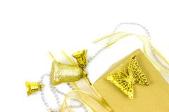 Christmas golden and silver decorations isolated on white background. Gold color gift box stock photos