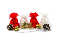 Christmas golden and silver decorations on white background. Royalty Free Stock Photos