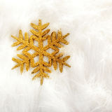 Christmas golden snowflake over white fur Stock Photos