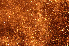 Christmas golden sparkle glitter background with bokeh, gold holiday happy new year stock image