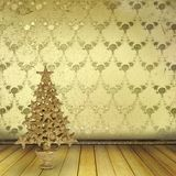 Christmas golden spruce in the old room. Decorated with wallpaper Stock Photography