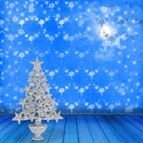Christmas golden spruce in the old room Royalty Free Stock Images