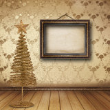 Christmas golden spruce in the old room Royalty Free Stock Image