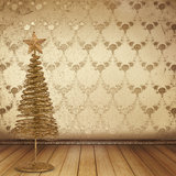 Christmas golden spruce in the old room. Decorated with wallpaper Stock Images