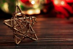 Christmas golden star on background of garland lights on black r Royalty Free Stock Image