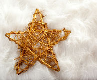 Christmas golden star over white fur Stock Images
