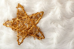 Christmas golden star over white fur Royalty Free Stock Images