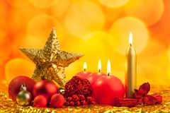 Christmas golden star with red candles Stock Photography