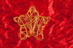 Christmas golden star of wire over red Stock Photo