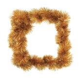 Christmas golden tinsel as frame. Royalty Free Stock Photo