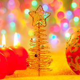 Christmas golden tree baubles and candles Royalty Free Stock Photo