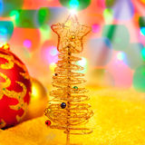 Christmas golden tree with baubles and lights Stock Photo