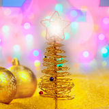 Christmas golden tree with baubles and lights Stock Image