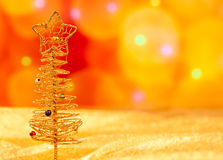 Christmas golden wire tree in blurred lights Royalty Free Stock Photography