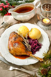 Christmas goose. Crusty Christmas goose leg with braised red cabbage and dumplings Stock Images