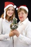 Christmas grandmother and granddaughter Stock Photo