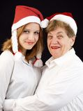 Christmas grandmother and granddaughter Stock Images