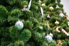 Christmas grass ball on tree with beautiful ornament Stock Photography