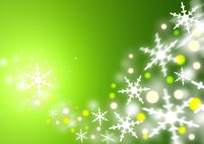Christmas Green. Gentle snowflakes blowing into swirls Stock Photos