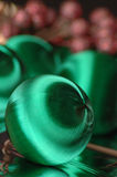 Christmas green. Green satin christmas balls Stock Photography