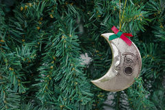 Christmas green background with moon ornament hanging, filtered Stock Photos