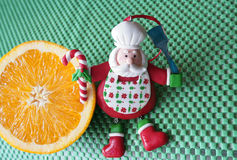 Christmas - green background,orange and funny chef Santa Claus Stock Photo