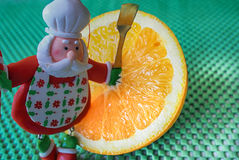 Christmas - green background,orange and funny chef Santa Claus Stock Photography