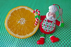 Christmas - green background,orange and funny chef Santa Claus Royalty Free Stock Images