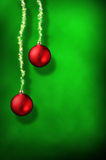 Christmas green background with red balls and ribbon stars verti Stock Image