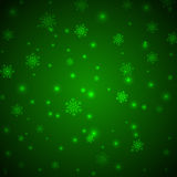 Christmas green background with snowflakes and glitter Stock Photography
