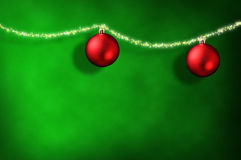 Christmas green background with two balls and ribbon stars horiz Royalty Free Stock Photos