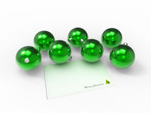 Christmas green baubles and christmas wishes card Royalty Free Stock Image