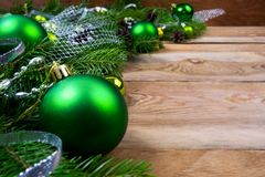 Christmas green baubles on wooden background, copy space royalty free stock images