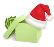 Christmas Green Box And Santa Hat. Stock Photo