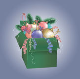 Christmas green box with baubles. Background decoration Stock Photography
