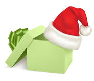 Christmas green box and santa hat. Stock Photo