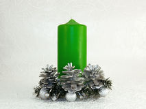 Christmas green candle, cones and silver balls Stock Photography