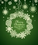 Christmas green card  with hanging wreath with paper snowflakes Royalty Free Stock Photography