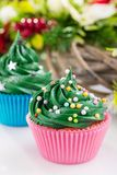 Green christmas cupcaks with festive decorations stock photos