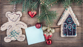 Christmas green fir tree with toys on a wooden board. New Year background Royalty Free Stock Photo