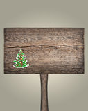 Christmas green fir tree on a wooden board Royalty Free Stock Photos
