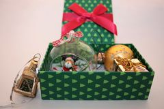 Christmas green gift box with presents on light background stock images