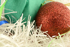 Christmas green gift with red balls Royalty Free Stock Photo