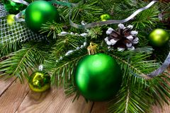 Christmas green ornament wreath on the wooden background, copy s. Christmas green ornament and silver ribbon wreath on the rustic wooden background, copy space royalty free stock image